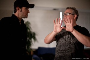 "Director of photography Guy Livneh talks to Director A.J. Carter on set on ""23"""